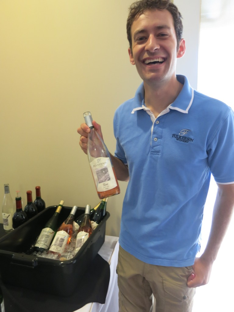 The personable Steven Fulkerson, holding a bottle of his bright and fruity Pinot Noir/Dornfelder rosé